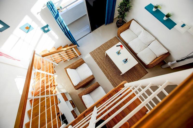 Stylish ratan sofa set with a modern living room table