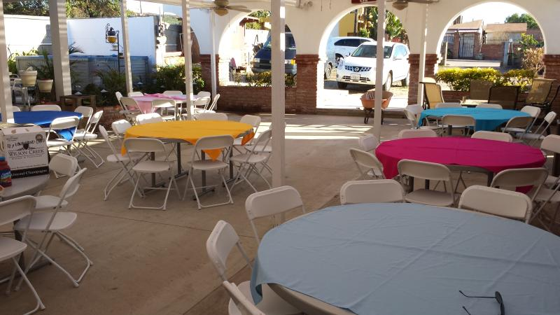 Covered patio for up to 100 people with tables and chairs included