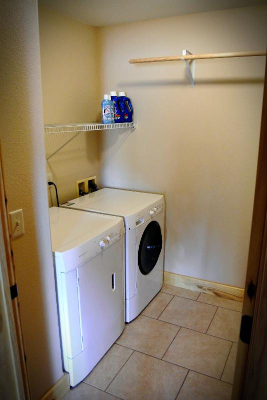 Laundry room with washer and dryer, detergent, fabric softener etc.