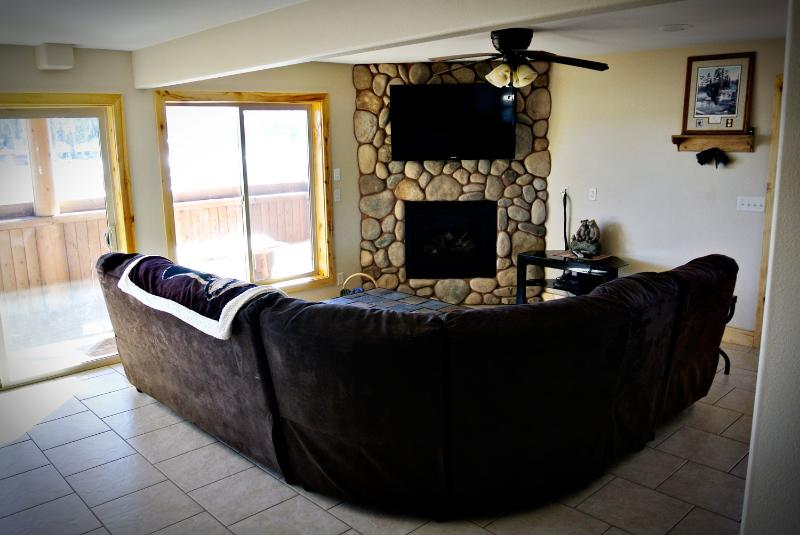 Living area with flat screen TV, DVD player and beautiful views into Duck Creek meadow.