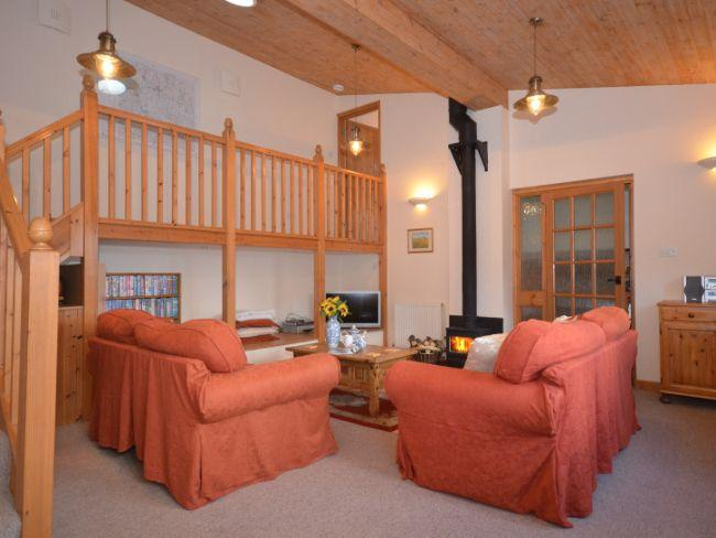 Lounge with woodburner and galleried landing