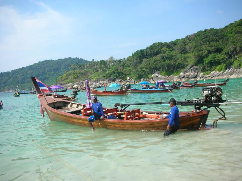 Hire long tail boat to outlying islands