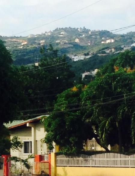 View of Red Hills From Outside on Street