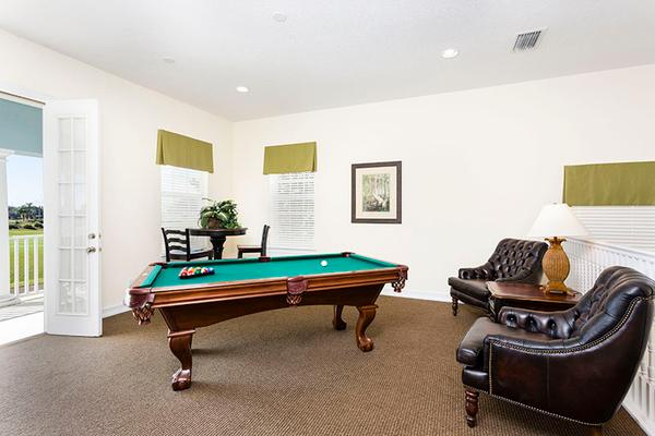 The upper area with a pool table and tv.