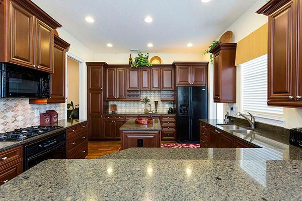 The kitchen with granite kitchen tops, dishwasher, microwave,large fridge etc.