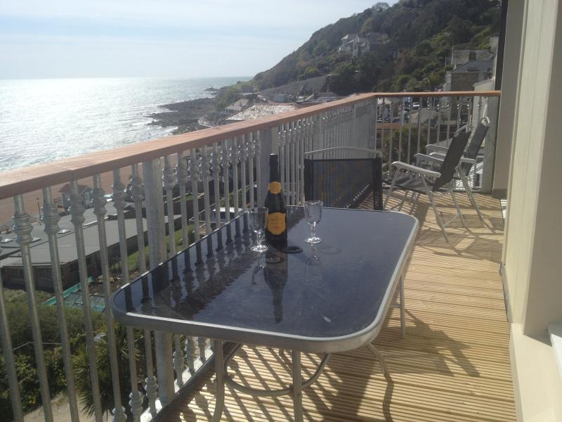 A glass of bubbles on the balcony whilst watching the waves roll in (and kids play!)