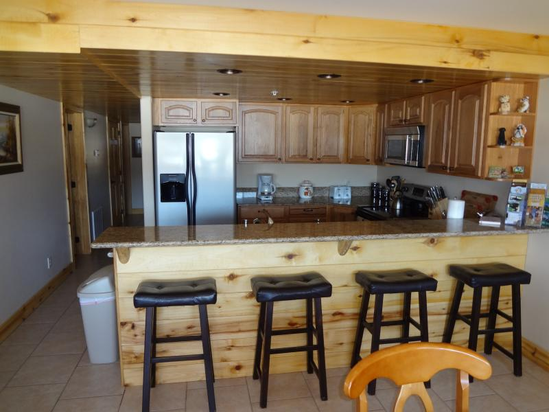 Kitchen with bar top.