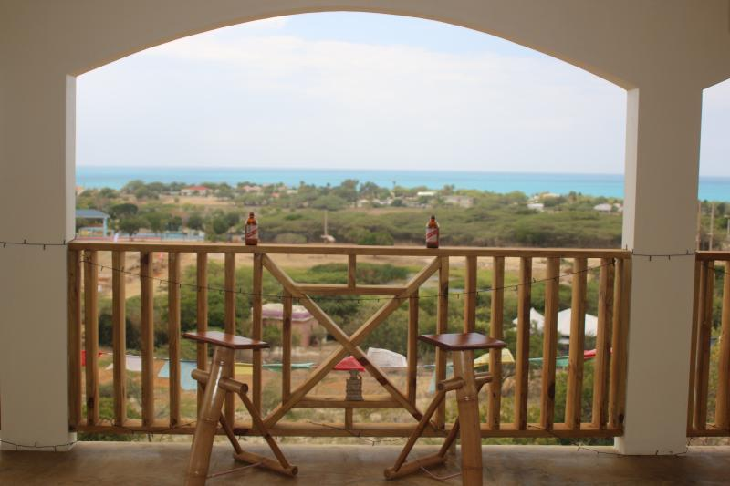 Watch a rousing game of football (soccer) or cricket, or just enjoy the view from the veranda