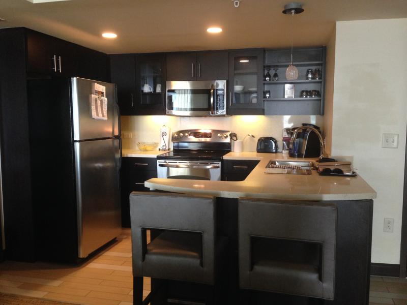 Full kitchen with stainless steel appliances and granite countertops
