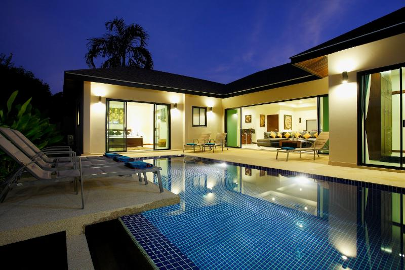 Beautiful outside lighting inviting guests to enjoy outside entertaining well into the evening