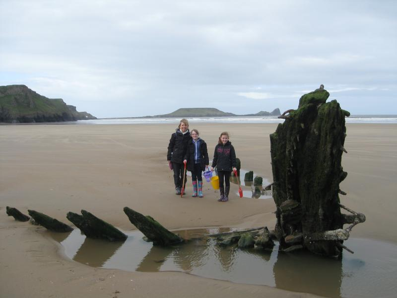The wreck of the 'Helvetia' on Rhossilli beach, (with landlubbers just about to start a beach walk).