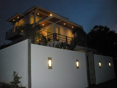 The Villa by night - well lit, includng gardens and gated (remote) driveway