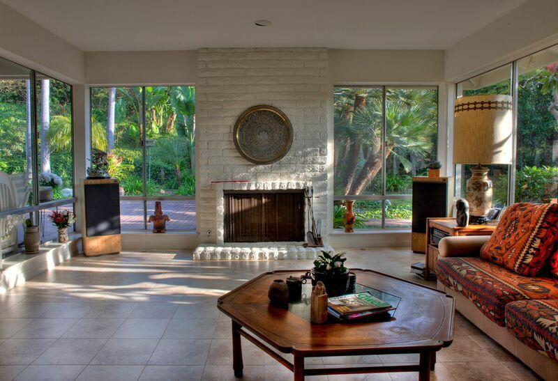 Living room and fireplace with view of the garden