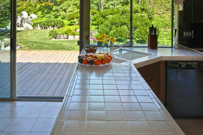 Kitchen counter with view of the patio and garden.