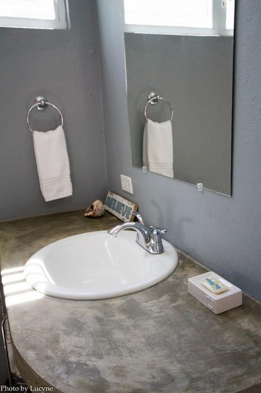 Casa de banho privada com pé no chuveiro