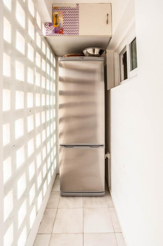 Large fridge in the loggia attached to the kitchen