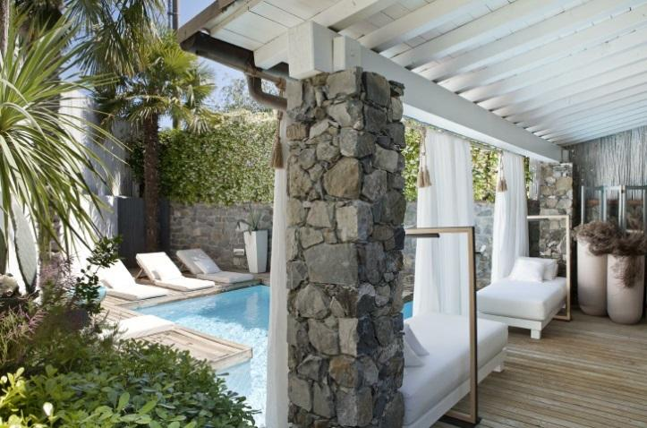 bisazza mosaic pool, sunbeds and outdoor patio with four settees