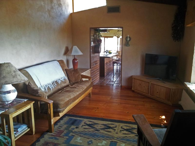 The den offers a separate TV room with futon sofa, 46' smart TV...