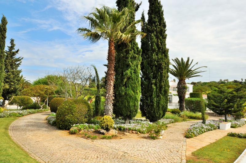 Garden paths from Beachcomber entrance gate towards the villa.