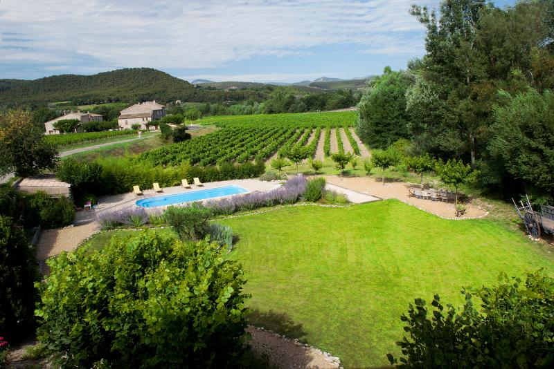 Spacious garden with heated swimming pool and view of the hills