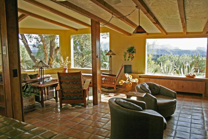 The great room has an open feel that connects and harmonizes with the outside...
