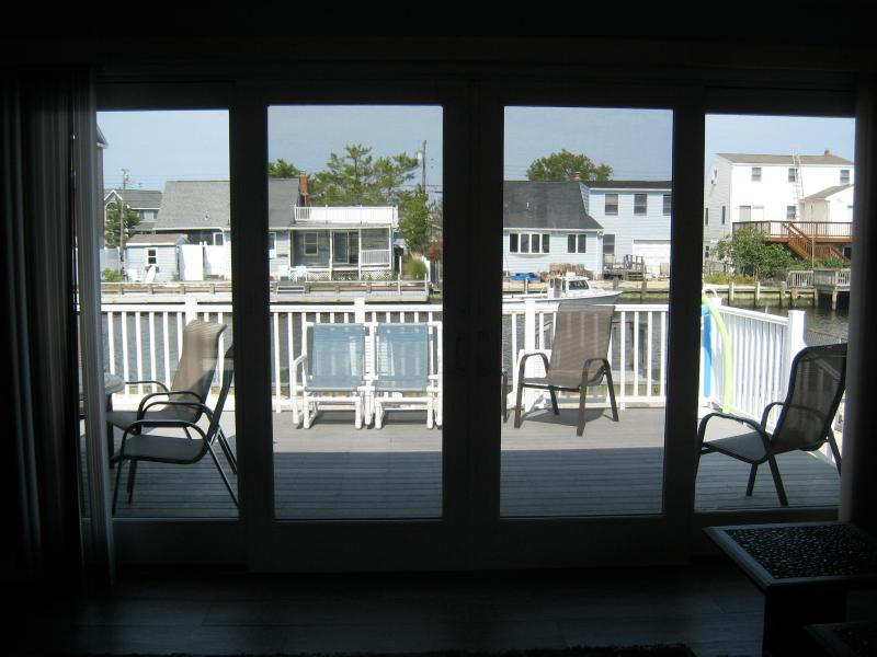 12' sliding glass door view out onto deck and water beyond