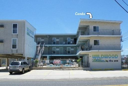 A parking space is included. The unit is the 3rd floor corner (under arrow.) Catches ocean breezes!