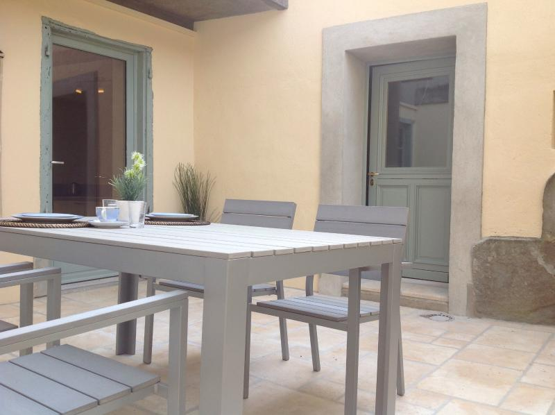 Large Private Courtyard with dining furniture for four.
