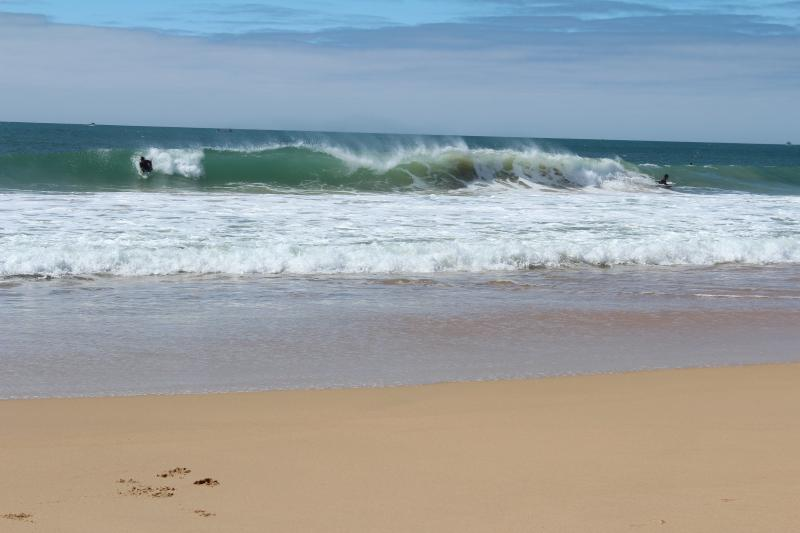 supertubos beach in front of the house next level surf camp