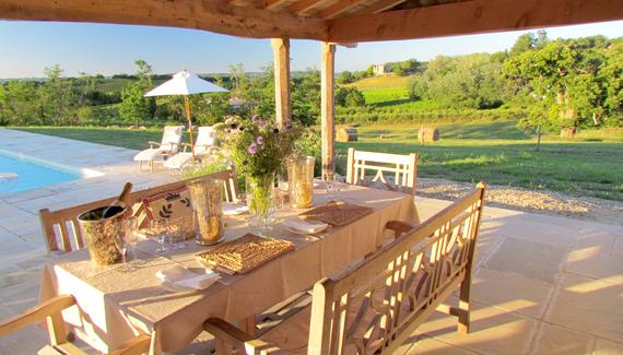 The covered terrace overlooking the pool and far reaching views over vineyards and orchards.