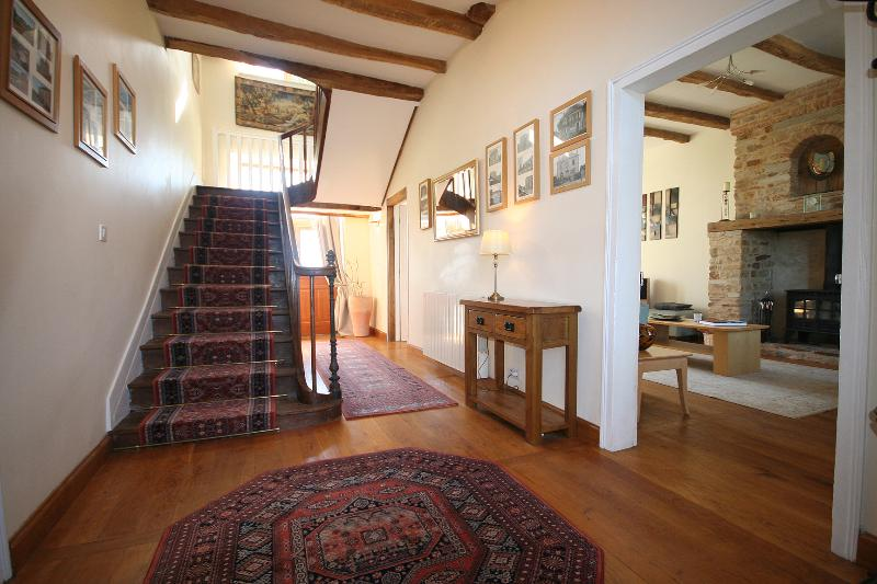 Spacious hallway with antique oak staircase