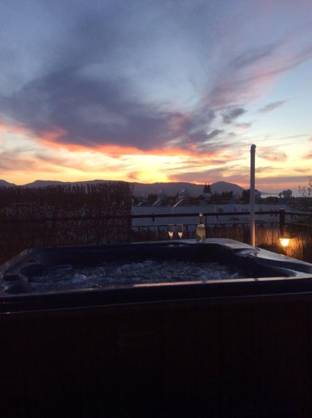 Enjoy the jacuzzi bubbles and a glass of bubbly while watching a stunning sunset over the Akamas