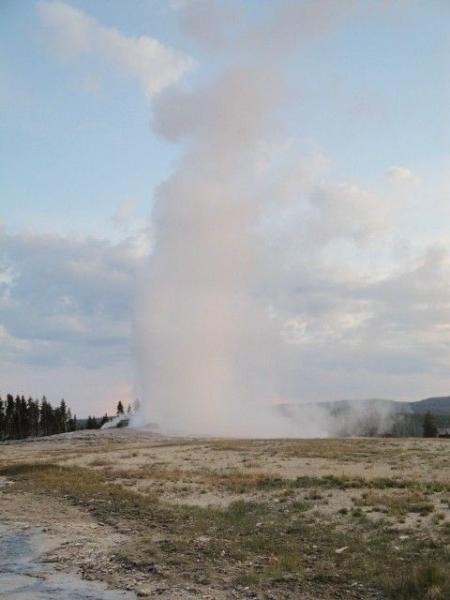 Old Faithful erupting in Yellowstone Park