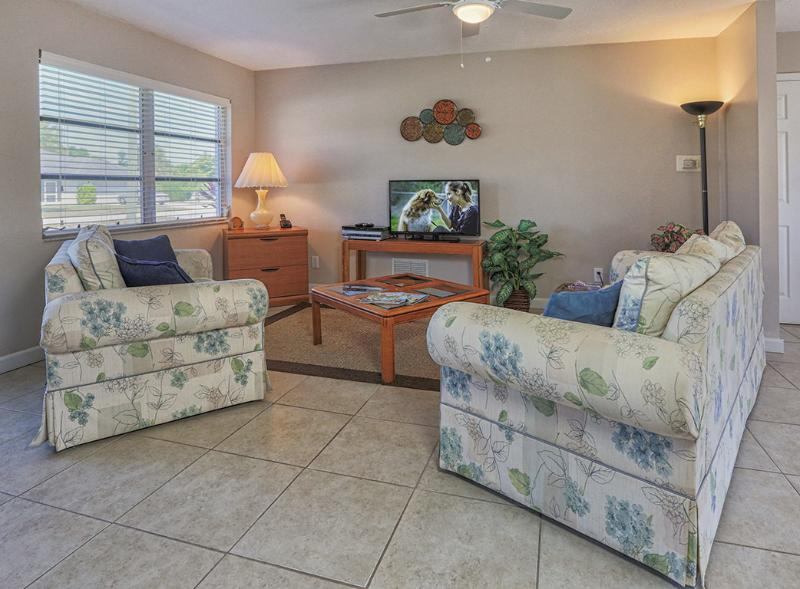 Living room features a 39 inch flat screen high definition TV