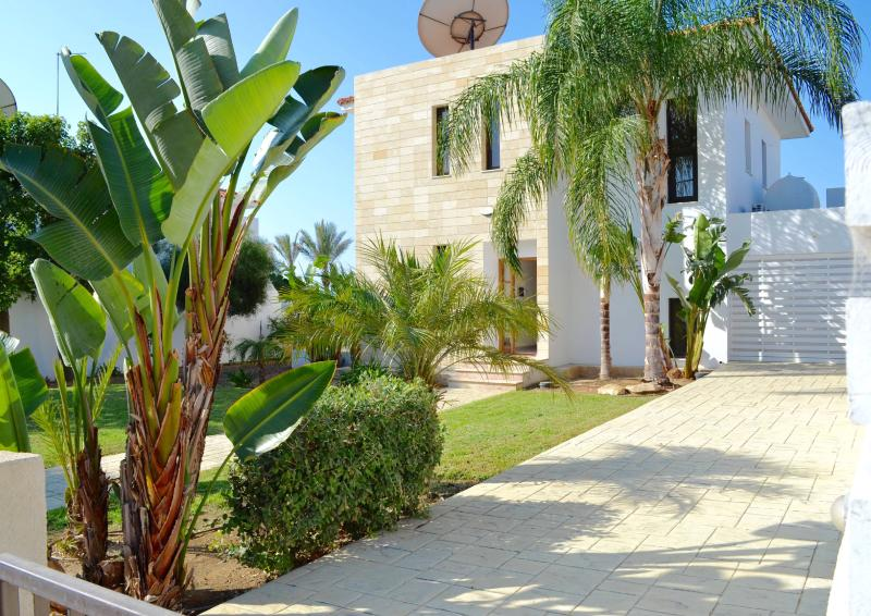 Large front garden with private parking