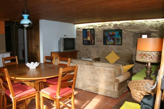 Living room and dining room of the House
