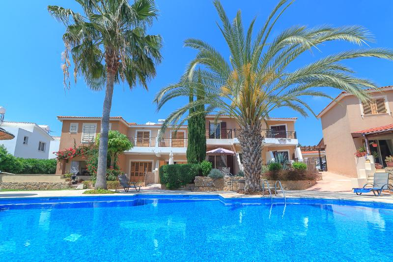 Beautifully maintained pool with sun loungers and chairs