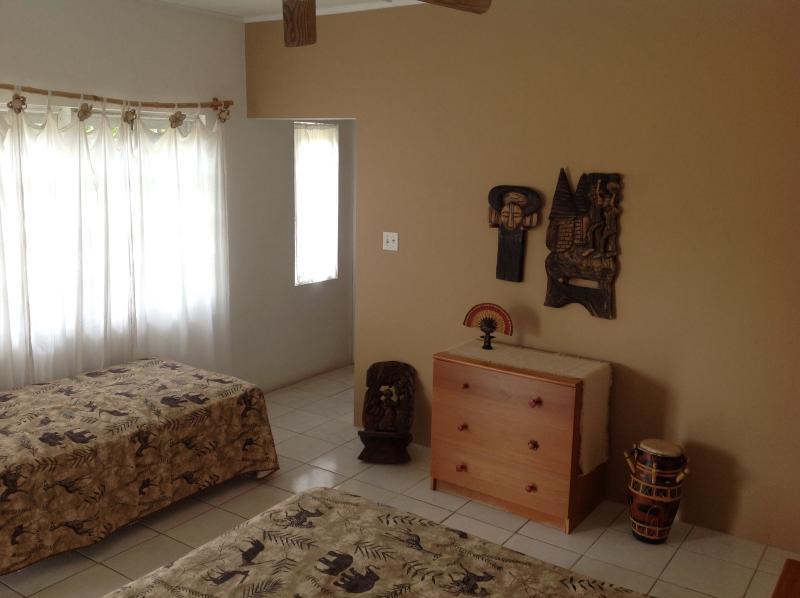 upper bedroom. A/C, en suite bathroom and additional roll away bed.