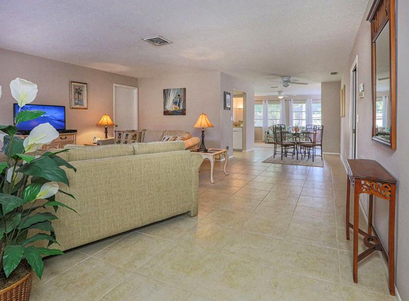 Floor plan is open with bedrooms separated by the living area