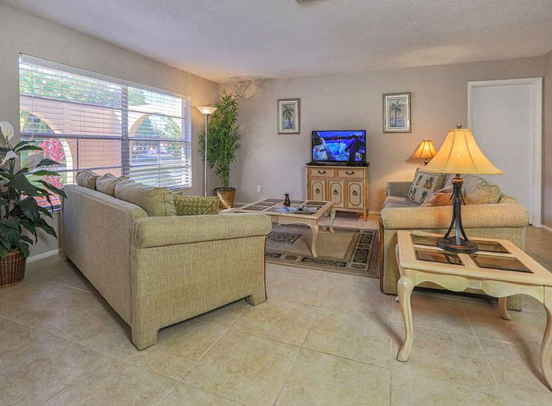 Comfortable living room has large flat screen TV with HD channels