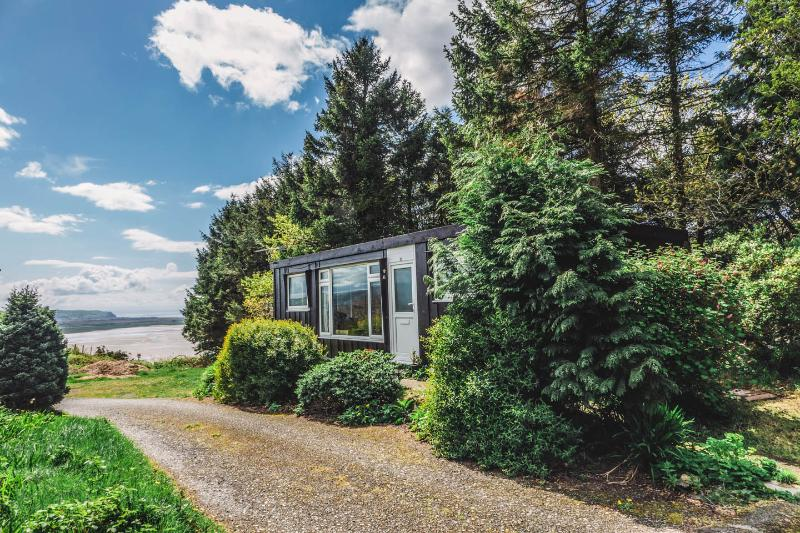 Idyllic sunny position with woods behind and wonderful panoramic views over the estuary