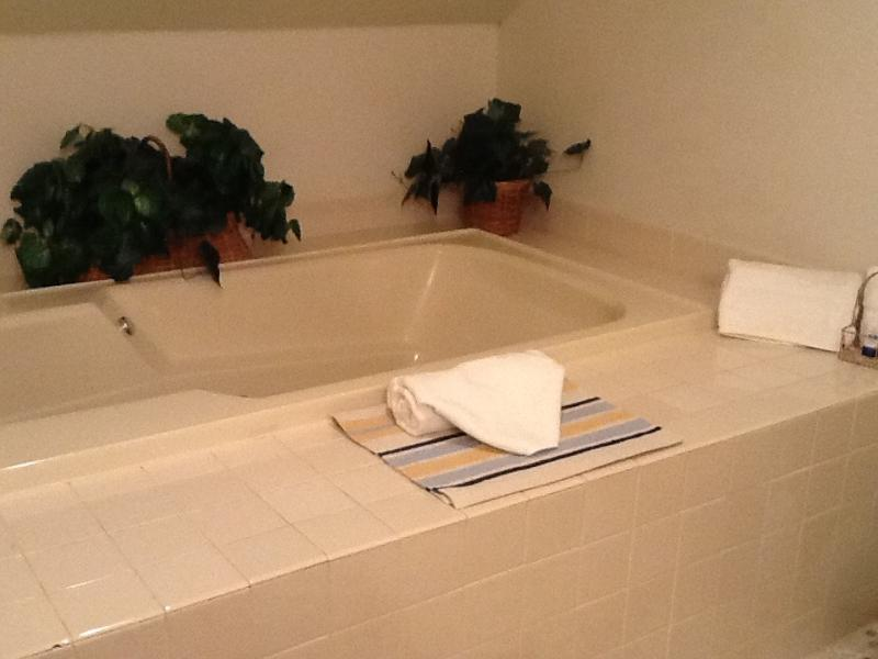 Soak in our updated bathroom's jacuzzi tub.