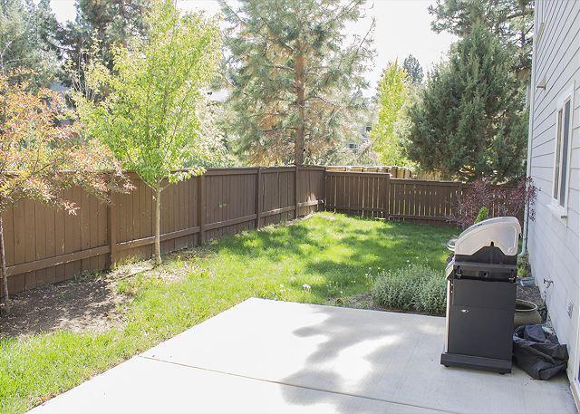 Fenced backyard with BBQ
