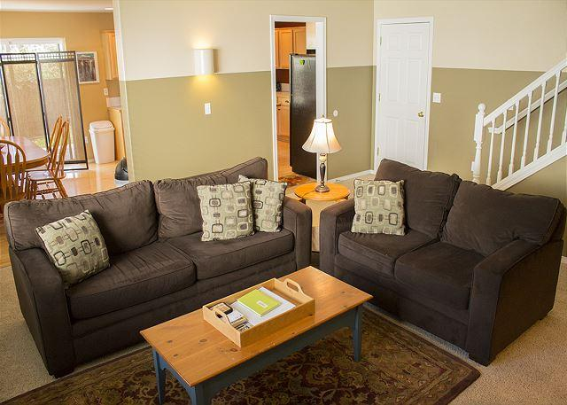 Relax on the two couches in the living room