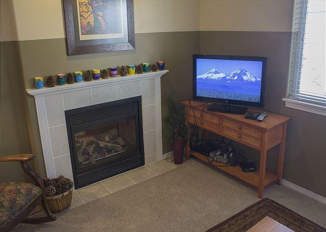 Gas fireplace and flat screen TV in the living room
