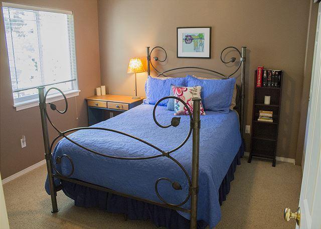 Queen bed in the upstairs bedroom