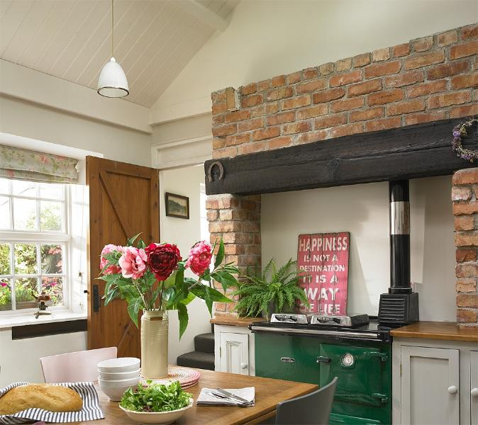 The kitchen looks out onto a sunny courtyard beyond
