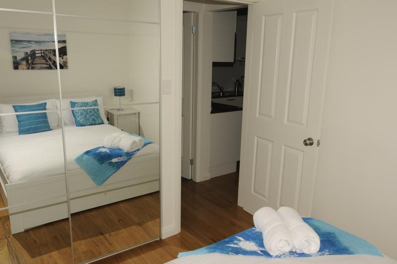 Comfy queen bed with plenty of space in the mirrored wardrobe