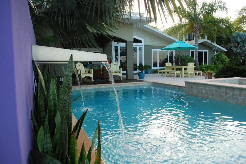 Sparkling Pool/Spa with waterfalls. Direct water views. A private paradise. Ahhh!