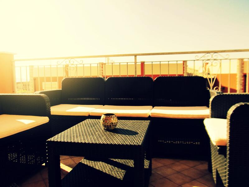 Chill out on this large sofa set while watching the sun set from the terrace